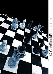chess board - chess pieces on chess board showing...