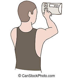 Adjust Thermostat - An image of a man adjusting a thermostat...