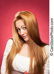 Portrait of a blond woman - Studio portrait of a blond woman...