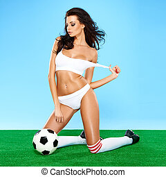 Sensual gorgeous brunette soccer player with a beautiful...
