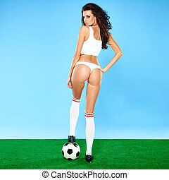Beautiful busty woman soccer player in lingerie - Beautiful...