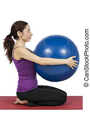 Fitness woman with a pilates ball, vertical - Fitness woman...