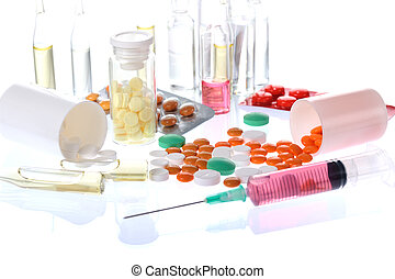 medicine - colorful pills, ampules, syringle on white...