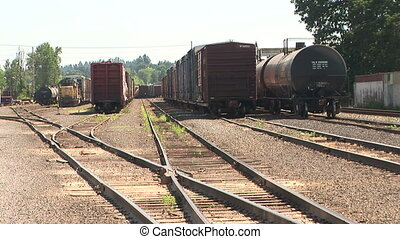 Freight Train Cars - Railroad cars waiting at a train yard,...