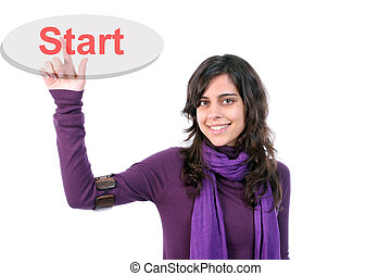 Young girl presses the Start key, isolated in white...