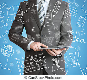 Man with tablet in hands and business sketches - Businessman...