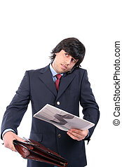 Young business man talking on cellphone, isolated on white...