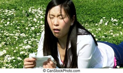 Asian woman with bad allergy sick
