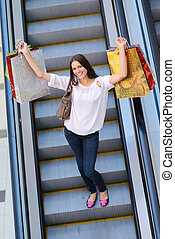 Happy young woman in a shopping mall - Happy young woman on...