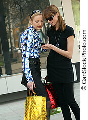 shopping women on the street with a mobile phone