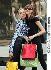 shopping women - two women friends with shopping bags