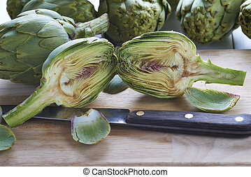 Fresh artichokes to cook - Fresh artichokes on the table of...