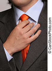 Detail of a man, fixing his tie