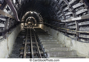 Underground tunnel in the coal mine - Illuminated,...