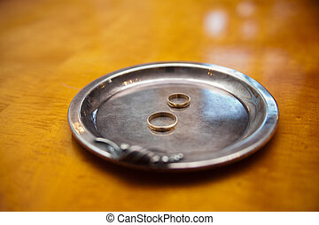 Two gold wedding rings on silver tray in Registry Office