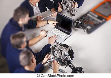 Engineers thinking over technical improvment - Group of...