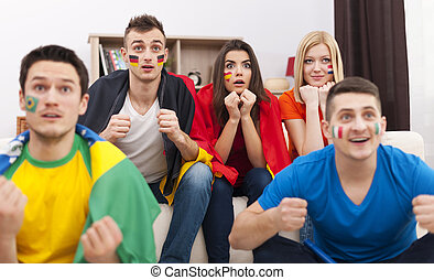 Portrait of young soccer fans during the watching match on...