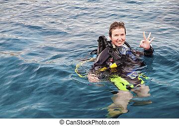 Scuba Diver - Portrait of a female scuba diver on the...