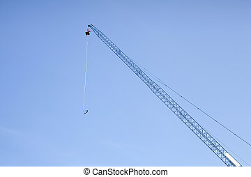 Bungee jump - A man in the second phase of bungee jump.A...