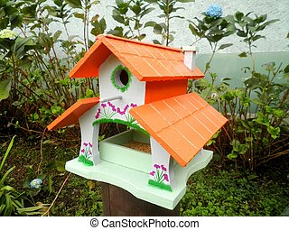 Wooden Birdhouse in Garden - Beautiful wooden birdhouse in...