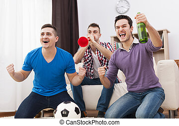 Young football fans supported soccer on TV