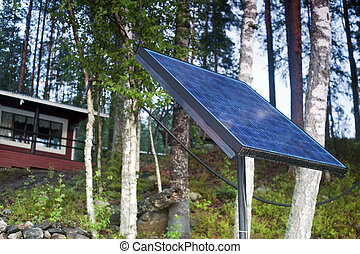 Solar Panel - Close up of solar panel with small house...