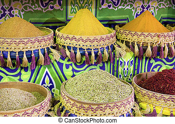 Spice market - Heap of colorful, powdered spices in african...