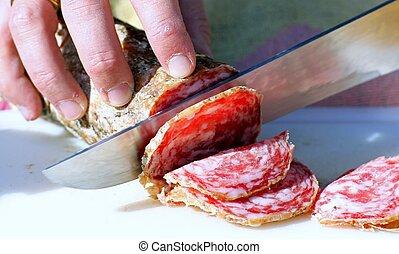 salami sliced by butcher's hands