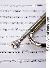 Trumpet and notes - Brass music instrument - golden trumpet...