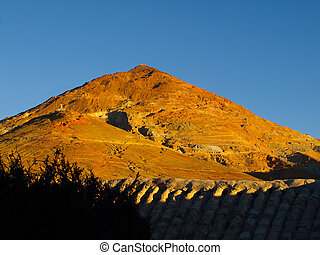 Silver mountain in red evening sunlight