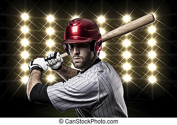 Baseball Player in front of lights.