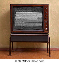 TV - Retro TV on a background of vintage wallpaper in old...