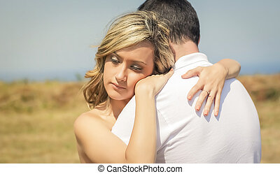 Love couple embracing outdoors on a summer day - Beautiful...