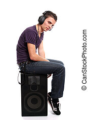 Young casual man listening to music, isolated in white...