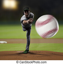 Pitcher Baseball Player on a Green Uniform on baseball...