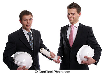 two business man with safety hats, exchanging a new project,...