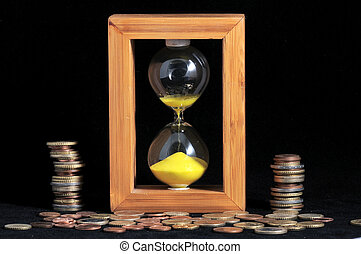 Time is money concept - Huorglass and coins- Time is Money...