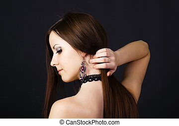 Beautiful young girl in profile with long straight hair on a...