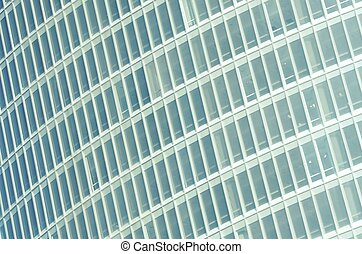 glass facade - forefront of the glass facade of a skyscraper