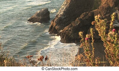 Washington Coast - Sea cliffs and ocean into inlet, Ilwaco,...