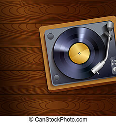 Vinyl record player on wooden background - Vintage retro...