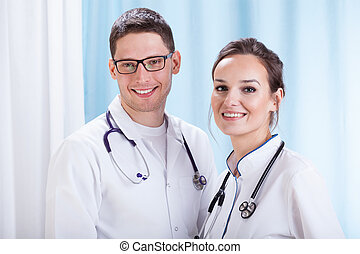 Young male and femal doctors' portrait in the office