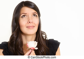 Sorrowful woman clutching a single rose - Sorrowful...