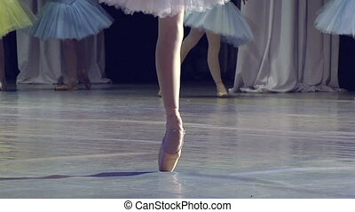 Ballerina Dancing - ballerina on stage glow of spotlights....