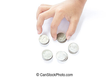 Hands of children and coins