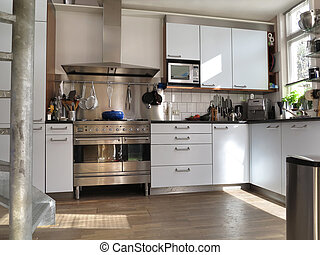 Modern kitchen interior with sunlight on wooden flor