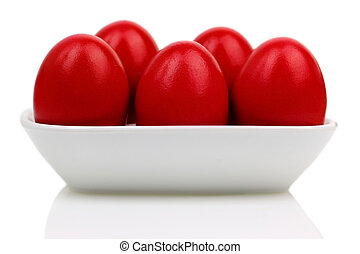Red Easter eggs in a b?wl