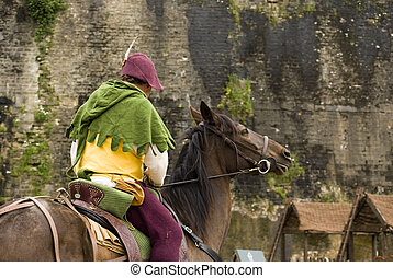 A bard mounted on a horse in Medieval Festival of Sedan,...