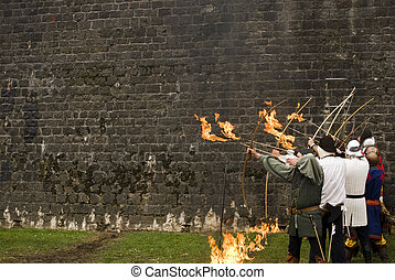 Rank of archers with flaming arrows - A rank of archer with...