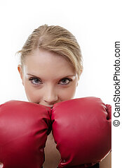 keeping fit - woman wearing boxing gloves looking at camera
